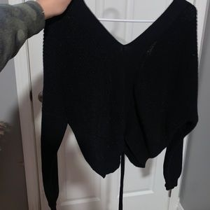 V neck sweater with lace up back